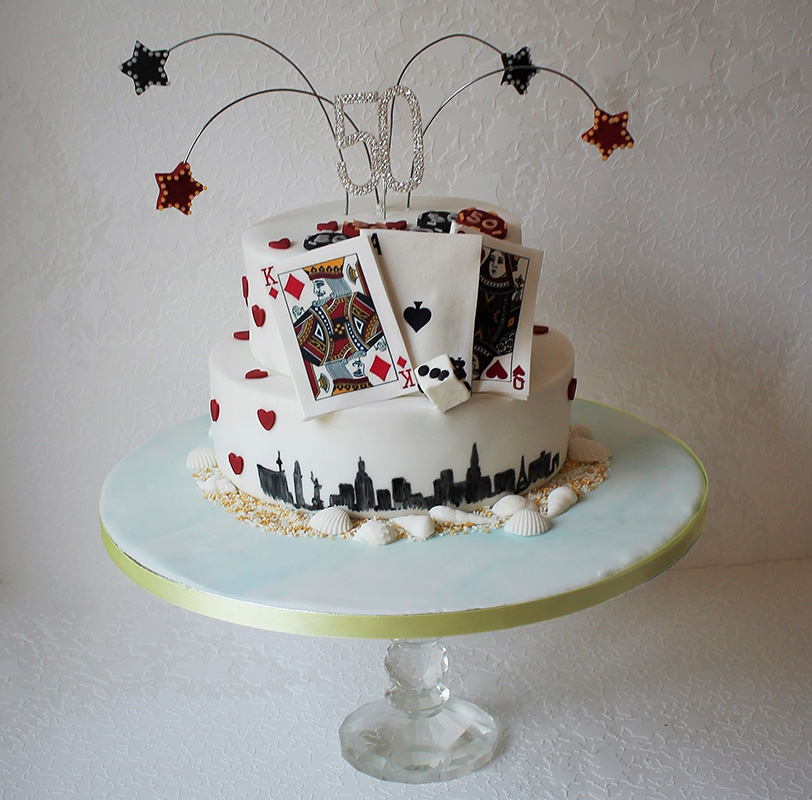 Las Vegas themed cake with playing cards, poker chips and stars