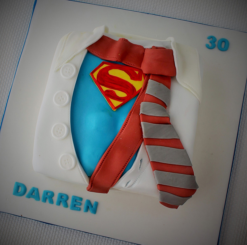Superman costume showing through shirt and tie