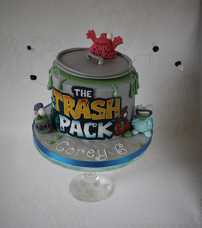 Trash Pack dustbin cake surrounded by monsters and flies