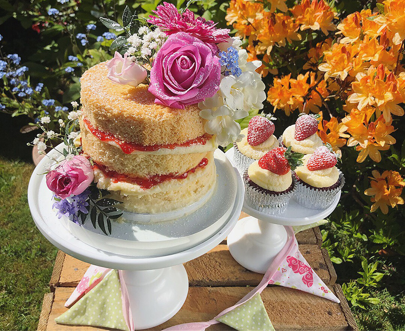 Naked Victoria sponge cake with fresh flowers
