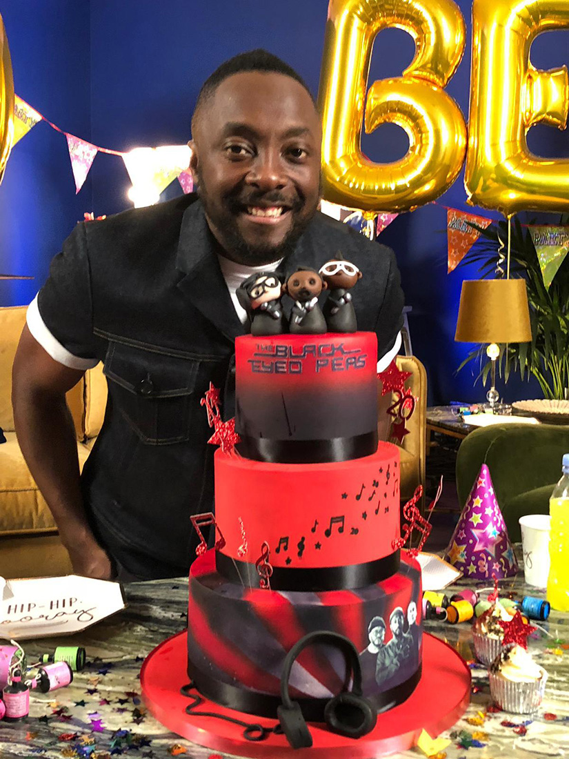 Will.I.Am with his 20th anniversary Black Eyed Peas Cake