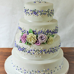 4 tier white and purple floral Wedding Cake