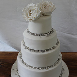 4 tier white Wedding Cake with flowers