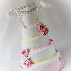 5 tier competition wedding cake with birds and roses