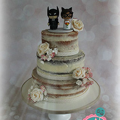 3 tier naked wedding cake with Batman toppers